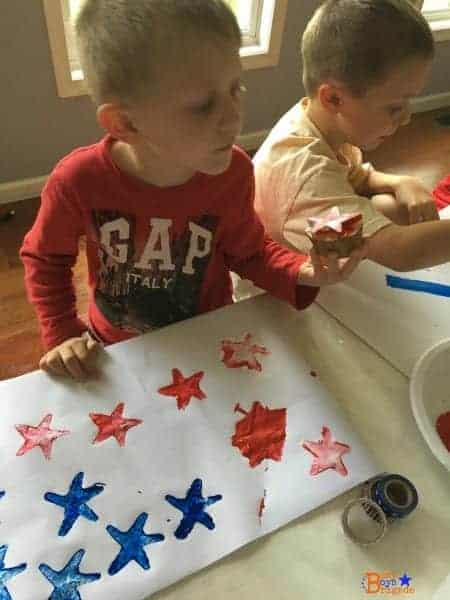 Using a star potato stamp to create patriotic crafts is such fun with kids!