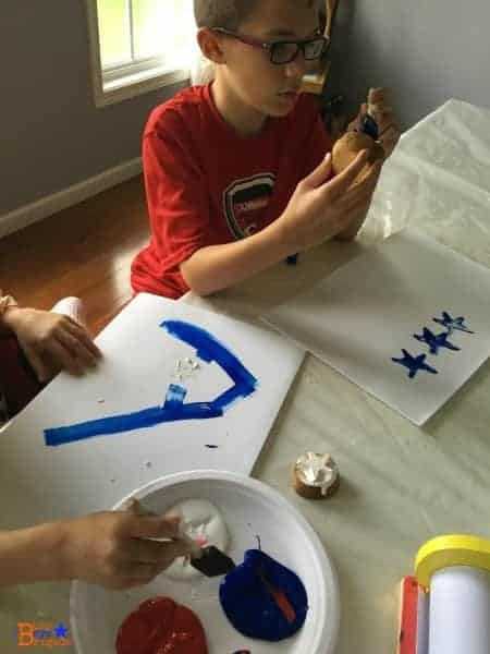 Painting with star potato stamps is a fun and easy to make patriotic crafts with kids.